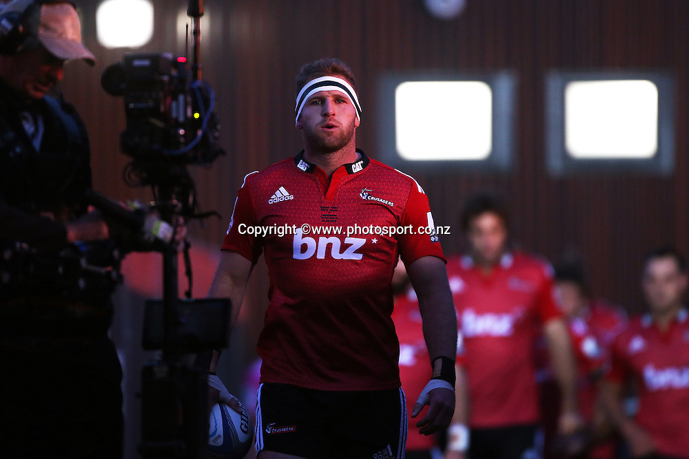 Kieran Read of the Crusaders leads the team out in his 100th super rugby game before the Investec Super Rugby between Crusaders v Hurricanes at AMI Stadium, Christchurch. 28 March 2014 Photo: Joseph Johnson/www.photosport.co.nz