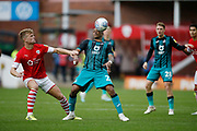 Cameron McGeehan of Barnsley and Swansea City forward Andre Ayew contest a loose ball  during the EFL Sky Bet Championship match between Barnsley and Swansea City at Oakwell, Barnsley, England on 19 October 2019.