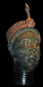 Brass head with a beaded crown and plume, from Ife, Nigeria.  Yoruba, probably 12th-14th century AD.