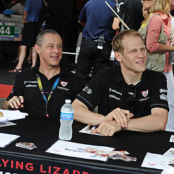 Flying Lizard Porsche drivers Jörg Bergmeister (right) and Seth Neiman sign autographs during the 2011 American LeMans Series Baltimore Grand Prix weekend.