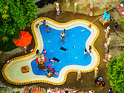 28 DECEMBER 2015 - SINGAPORE, SINGAPORE: People play in a hotel pool on Sentosa, a man made resort island off of Singapore. The island has beaches, hotels, attractions and hotels.       PHOTO BY JACK KURTZ