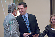 "18174Sales Celebration and Awards Ceremony, April 19, 2007. Walter Hall Rotunda...Mr. Tom Starr presenting Grand""Starr"" Award Drawing to Sean Othen"