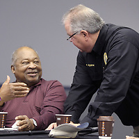 Adam Robison   BUY AT PHOTOS.DJOURNAL.COM<br /> Tupelo resident Lorenzo Mayfield talks with Bart Aguirre, Tupelo Police Chief, during coffee with cops. The informal get-together where poeple can share coffee and conversation with officers was held Friday morning at Life Changing Ministries in Tupelo.