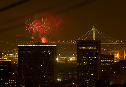 Fireworks explode above the cities of San Francisco and Oakland, Calif., to celebrate the 242nd anniversary of American independence, Wednesday, July 4, 2018. (Photo by D. Ross Cameron)