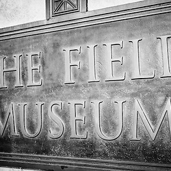Chicago Field Museum sign in black and white. The Field Museum is considered one of the best things to do in Chicago and is a top Chicago attraction.
