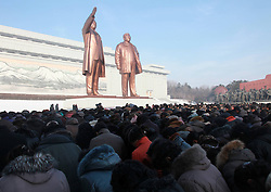 60833528  <br /> People pay tribute to the bronze statues of late top leaders Kim Il Sung and Kim Jong Il in Pyongyang, capital of the Democratic Peoples Republic of Korea (DPRK), Dec. 16, 2013. People gathered here on Monday to commemorate late leader Kim Jong Il for the second anniversary of his death which falls on Dec. 17. Monday, 16th December 2013. Picture by  imago / i-Images<br /> UK ONLY