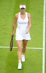 26.06.2013, Wimbledon, London, ENG, WTA Tour, The Championships Wimbledon, Tag 3, im Bild Caroline Wozniacki (DEN) looks dejected during three one of the WTA Tour Wimbledon Lawn Tennis Championships at the All England Lawn Tennis and Croquet Club, London, Great Britain on 2013/06/26. EXPA Pictures © 2013, PhotoCredit: EXPA/ Propagandaphoto/ David Rawcliffe<br /> <br /> ***** ATTENTION - OUT OF ENG, GBR, UK *****