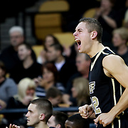 Central Florida guard Taylor Young (12) yells during the NCAA basketball game against the USF Bulls at the UCF Arena on November 18, 2010 in Orlando, Florida. UCF won the game 65-59. (AP Photo/Alex Menendez)