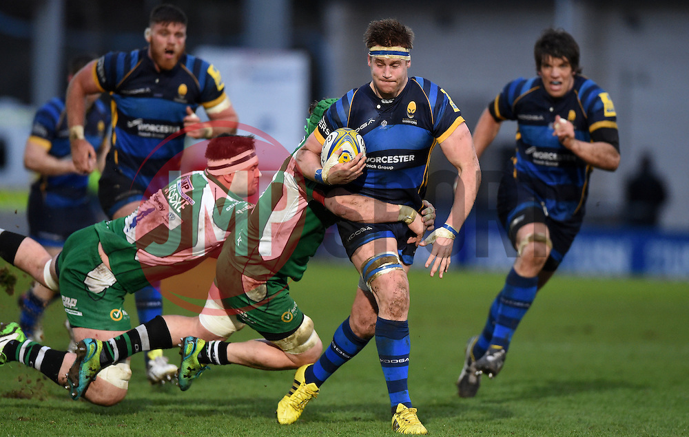 Worcester Warriors Number 8 GJ van Velze (C)avoids the tackle of Luke Narraway blindside flanker for London Irish  - Mandatory by-line: Joe Meredith/JMP - 26/03/2016 - RUGBY - Sixways Stadium - Worcester, England - Worcester Warriors v London Irish - Aviva Premiership