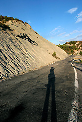 SPAIN ARAGON ANZANIGO 25AUG05 - Soil erosion and photographer's shadow in a landscape near Anzanigo in rural Aragon, on the road to Jaca...jre/Photo by Jiri Rezac..© Jiri Rezac 2005..Contact: +44 (0) 7050 110 417.Mobile:  +44 (0) 7801 337 683.Office:  +44 (0) 20 8968 9635..Email:   jiri@jirirezac.com.Web:     www.jirirezac.com..© All images Jiri Rezac 2005 - All rights reserved.