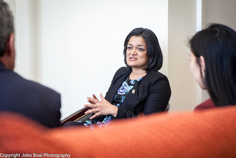 Representative Pramila Jayapal (D-WA, 7), and her legislative assistant, Jennifer Chan, right, meet with representatives of the Washington Bankers Association, on Tuesday, January 31, 2017.  John Boal photo/for The Stranger