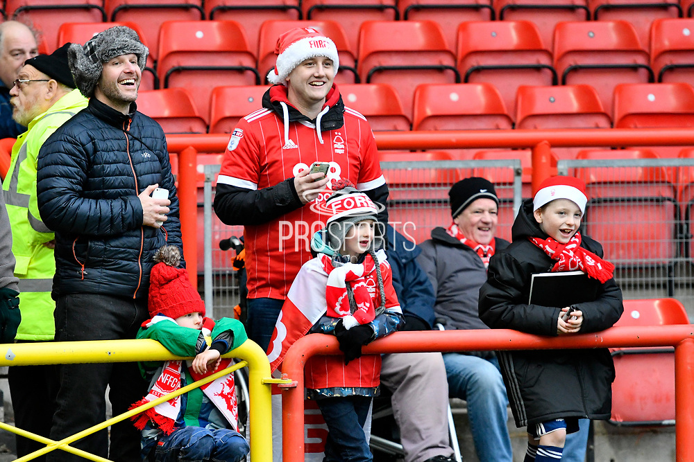 Forest fans with Christmas hats before the EFL Sky Bet Championship match between Bristol City and Nottingham Forest at Ashton Gate, Bristol, England on 16 December 2017. Photo by Graham Hunt.