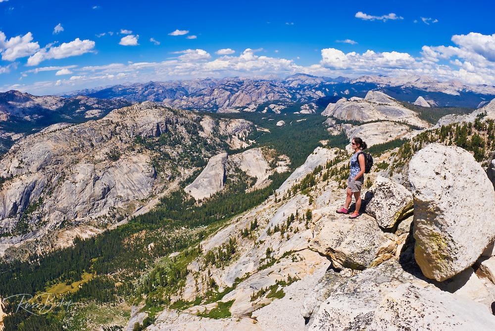 Climber on the summit of Tenaya Peak, Tuolumne Meadows area, Yosemite National Park, California USA