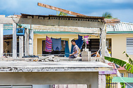 March 24, 2018, Toa Baja Puerto Rico, USA: A boy on second floor of a house in Toa Baja, a municipality located in the northern coast of Puerto Rico, 6 months after Hurricane Maria. Toa Baja was one of the hardest hit communities by Hurricane Maria.