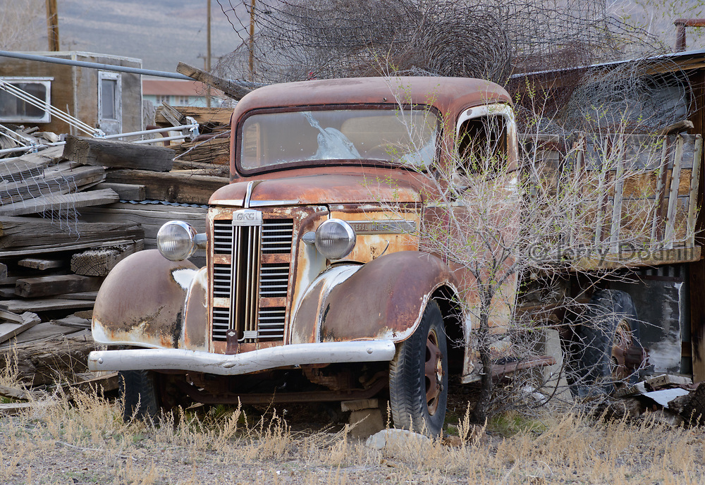 A rusty old GMC truck sits in a yard off State Highway 95 in Rural Mina, Nevada