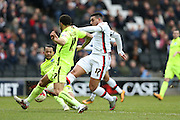 Milton Keynes Dons midfielder Daniel Powell (17) has a shot during the Sky Bet Championship match between Milton Keynes Dons and Brighton and Hove Albion at stadium:mk, Milton Keynes, England on 19 March 2016.