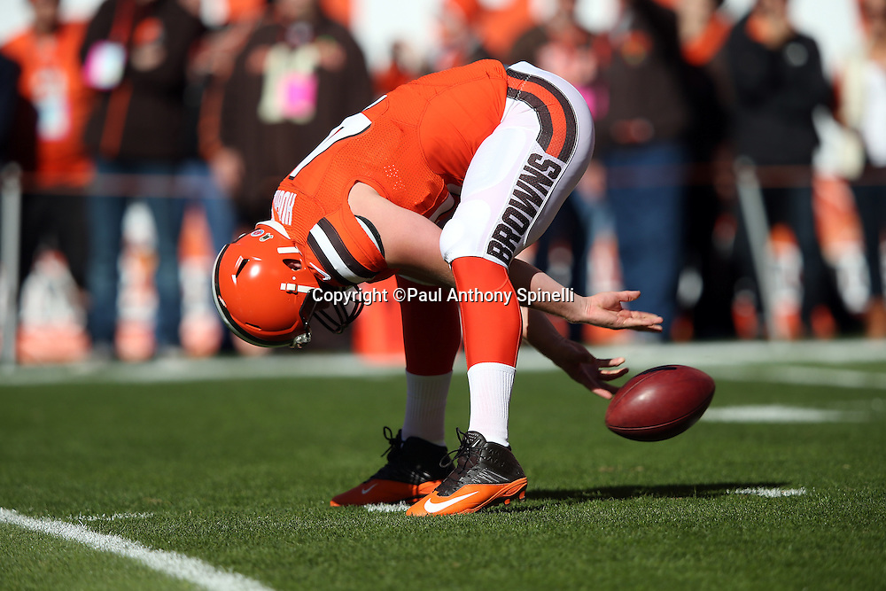 Cleveland Browns long snapper Charley Hughlett (47) long snaps while warming up before the 2015 week 8 regular season NFL football game against the Arizona Cardinals on Sunday, Nov. 1, 2015 in Cleveland. The Cardinals won the game 34-20. (©Paul Anthony Spinelli)