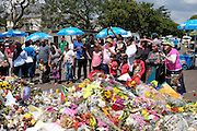 Mourners gather to lay flowers and pay their respects outside Nelson Mandela's house in Houghton Johannesburg. South Africa<br /> <br /> Thursday 12th December 2013<br /> Picture by Zute Lightfoot