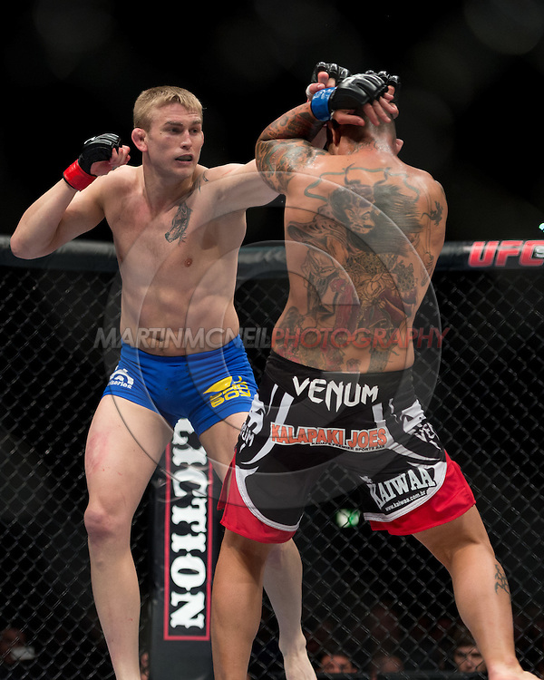 "STOCKHOLM, SWEDEN, APRIL 14:  Alexander Gustafsson (blue trunks) and Thiago Silva (black/red shorts) during ""UFC on Fuel TV: Gustafsson vs. Silva"" inside the Ericsson Globe Arena in Stockholm, Sweden"