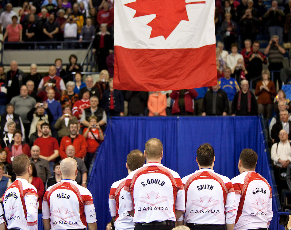 during the gold medal game at the Ford World Men's Curling Championships in Regina, Saskatchewan, April 10, 2011.<br /> AFP PHOTO/Geoff Robins