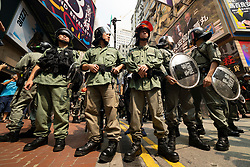 Hong Kong. 29 September, 2019. Illegal march by thousands of pro-democracy supporters from Causeway Bay to Government offices at Admiralty. Police unsuccessfully tried to stop march at start with teargas fired and scuffles. March marked the 5th anniversary of the start of the Umbrella Movement. Riot police control crowds in busy Causeway bay before march.