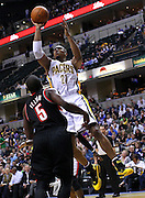 March 13, 2012; Indianapolis, IN, USA; Indiana Pacers power forward David West (21) shoots over Portland Trail Blazers point guard Raymond Felton (5) at Bankers Life Fieldhouse. Mandatory credit: Michael Hickey-US PRESSWIRE