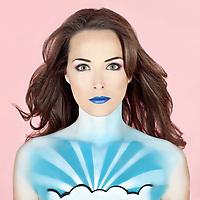 Closeup portrait of a beautiful woman with body painted to look like the sky