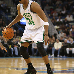 Feb 10, 2010; New Orleans, LA, USA; Boston Celtics forward Paul Pierce (34) controls the ball against the New Orleans Hornets during the first half at the New Orleans Arena. The Hornets wearing special Mardi Gras themed uniforms defeated the Celtics 93-85. Mandatory Credit: Derick E. Hingle-US PRESSWIRE