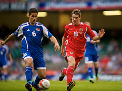CARDIFF, WALES - Saturday, October 11, 2008: Wales' Sam Vokes and Liechtenstein's Martin Stocklasa during the 2010 FIFA World Cup South Africa Qualifying Group 4 match at the Millennium Stadium. (Photo by David Rawcliffe/Propaganda)