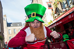 DUBLIN, REPUBLIC OF IRELAND - Friday, March 24, 2017: A Wales supporter wearing a Leprechaun hat and a stick on Ginger beard outside the Temple Bar, Dublin ahead of the 2018 FIFA World Cup Qualifying Group D match against Republic of Ireland. (Pic by Paul Greenwood/Propaganda)