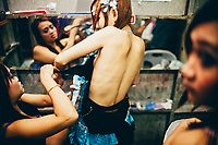 Ant changes backstage at the music club where she works. Ant is a 21-year-old ladyboy performer who has been taking female hormones since she was 12, in the form of over-the-counter birth control pills.