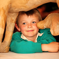 The Clonakilty Primary Schools Exhibition (Part 1) was kindly opened by Cllr Cionnaith &Oacute; S&uacute;illeabh&aacute;in, Mayor of Clonakilty on Thursday 23rd May. The opening was very well attended by the young artists who were exhibiting and their parents.<br /> Pictured was Luca O Riain pictured peeing through the Papier-m&acirc;ch&eacute; dogs which the community built.<br /> Picture: Emma Jervis Photography