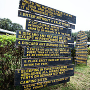 Rules sign at Londorossi Gate, one of the National Park ranger gates to Kilimanjaro National Park, and the gate one must check in to when climbing the Lemosho Route of Mount Kilimanjaro.