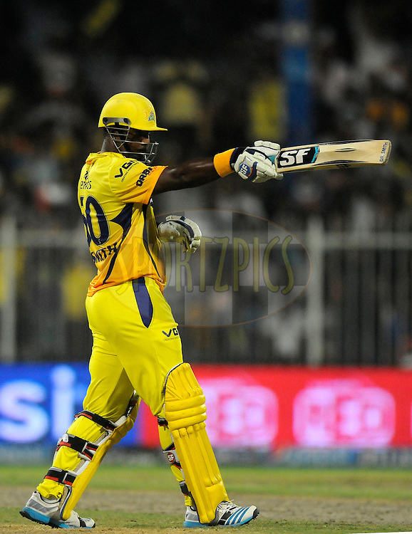 Dwayne Smith of The Chennai Superkings raises his bat after scoring a half century during match 16 of the Pepsi Indian Premier League 2014 between the Delhi Daredevils and the Mumbai Indians held at the Sharjah Cricket Stadium, Sharjah, United Arab Emirates on the 27th April 2014<br /> <br /> Photo by Pal Pillai / IPL / SPORTZPICS