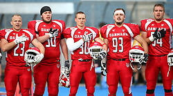 02.06.2014, UPC Arena, Graz, AUT, American Football Europameisterschaft 2014, Gruppe B, Daenemark (DEN) vs Frankreich (FRA), im Bild Jimi Smidt  Laursen, (Team Denmark, LB, #23),  Tobias Solver  Rehling, (Team Denmark, OL, #50),  Hans  Niels Christiansen, (Team Denmark, DB, #30),  Nichlas Christian  Steglich, (Team Denmark, DL, #93) und  Brian Pilgren  Mortensen, (Team Denmark, OL, #54) waehrend der Nationalhymne // during the American Football European Championship 2014 group B game between Denmark and France at the UPC Arena, Graz, Austria on 2014/06/02. EXPA Pictures © 2014, PhotoCredit: EXPA/ Thomas Haumer