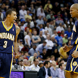 Oct 30, 2013; New Orleans, LA, USA; Indiana Pacers point guard George Hill (3) celebrates with power forward David West (21) after hitting a three point basket over New Orleans Pelicans point guard Jrue Holiday (not pictured) during the fourth quarter of a game at New Orleans Arena. The Pacers defeated the Pelicans 95-90. Mandatory Credit: Derick E. Hingle-USA TODAY Sports