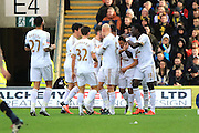 Swansea City midfielder Jefferson Montero celebrates with team mates after his goal during the The FA Cup third round match between Oxford United and Swansea City at the Kassam Stadium, Oxford, England on 10 January 2016. Photo by Jemma Phillips.
