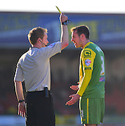 Notts County's Blair Adams gets a yellow card during the Sky Bet League 1 match between Swindon Town and Notts County at the County Ground, Swindon, England on 7 March 2015. Photo by Mark Davies.