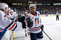 KELOWNA, BC - OCTOBER 12: Montana Onyebuchi #5 of the Kamloops Blazers celebrates a goal with fist bumps at the bench against the Kelowna Rockets at Prospera Place on October 12, 2019 in Kelowna, Canada. (Photo by Marissa Baecker/Shoot the Breeze)