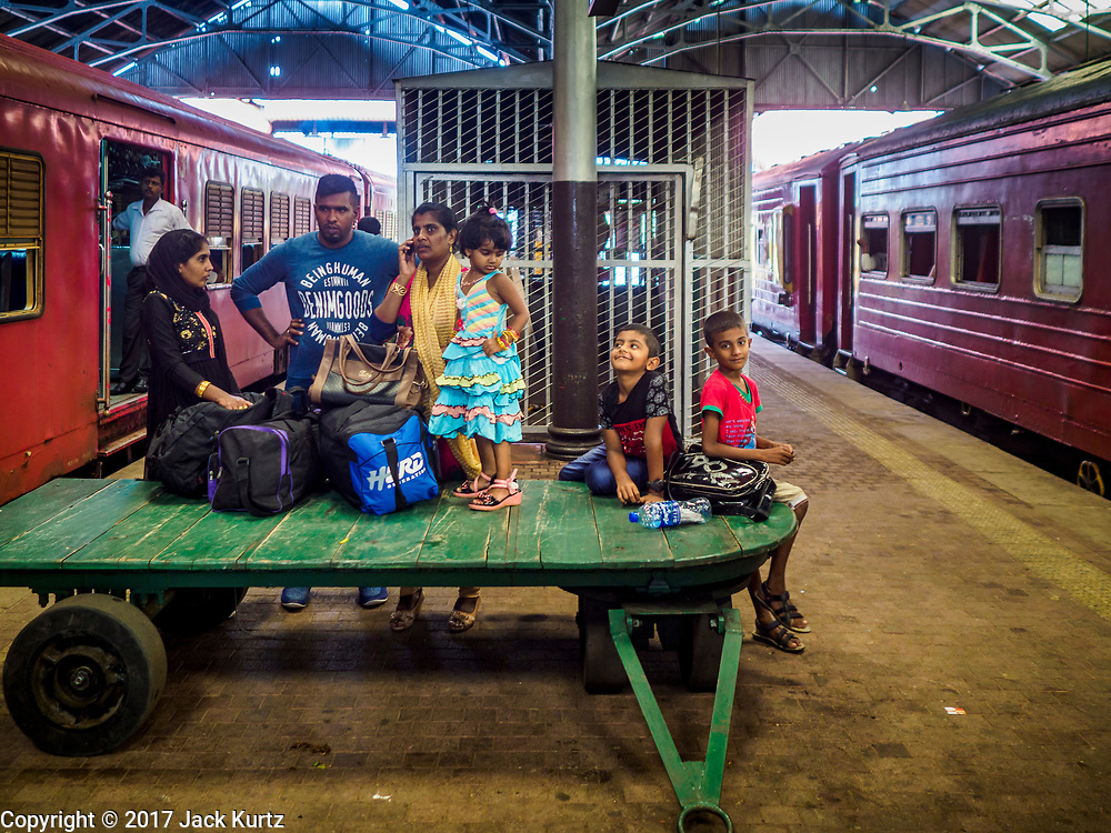 07 OCTOBER 2017 - COLOMBO, SRI LANKA: A family waits for their train at the Fort Station in Colombo. The Fort Station is Colombo's main train station and serves as the hub of Sri Lanka's train system. The station opened in 1917 and is modeled after Manchester Victoria Station.    PHOTO BY JACK KURTZ