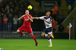 BOLTON, ENGLAND - Saturday, January 21, 2011: Liverpool's Martin Skrtel in action against Bolton Wanderers' David Ngog during the Premiership match at the Reebok Stadium. (Pic by David Rawcliffe/Propaganda)