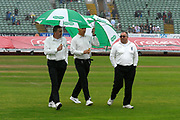The umpires out on the field for the 2:30 inspection walk off with umbrellas up as heavy rain falls again do further the delay in start of play during the Specsavers County Champ Div 1 match between Somerset County Cricket Club and Essex County Cricket Club at the Cooper Associates County Ground, Taunton, United Kingdom on 25 September 2019.