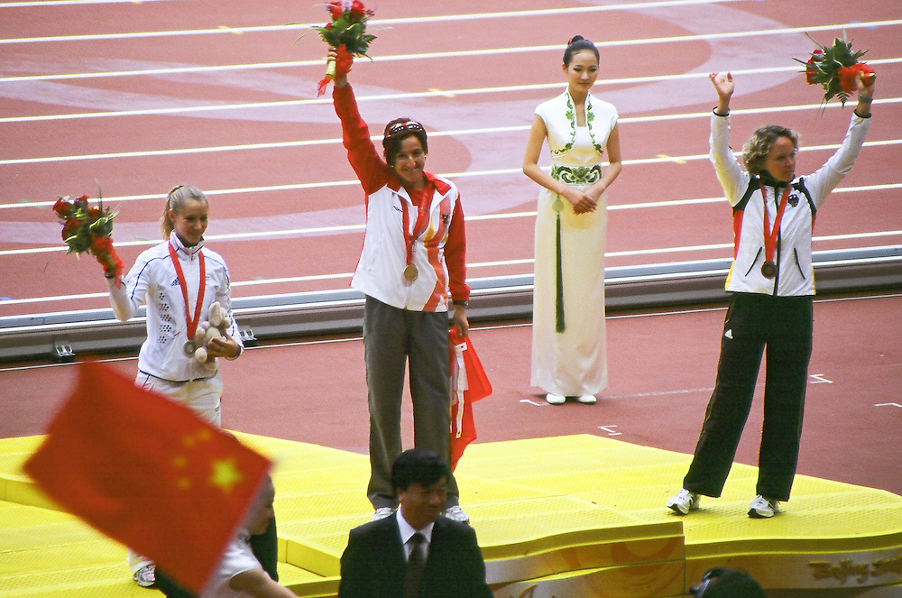 Paralympics Day 3 - Beijing 2008<br /> Women's Long Jump F44 podium<br /> Andrea SHERNEY (Aut) wins the gold medal at the women's long jump F44 final, with Marie-Am&eacute;lie LE FUR (Fra) in silver, and Astrid HOFTE (Ger)with bronze, at Paralympic Games. Beijing September 09 2008.