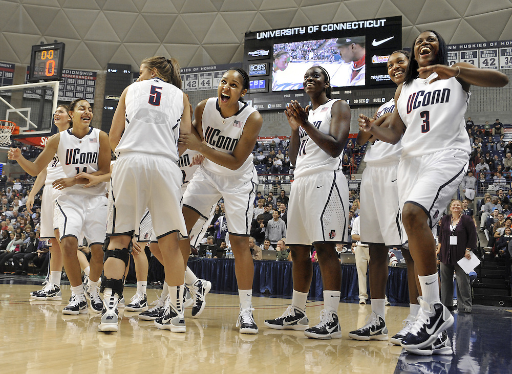 "Connecticut's women's basketball team reacts as teammate Lorin Dixon competes in a final round of the game ""Simon Says"" during First Night NCAA collegebasketball exhibition, in Storrs, Conn., Friday, Oct. 15, 2010. (AP Photo/Jessica Hill)"