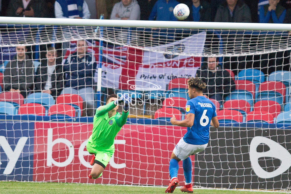 Macclesfield Town goalkeeper Owen Evans makes a save during the EFL Sky Bet League 2 match between Macclesfield Town and Morecambe at Moss Rose, Macclesfield, United Kingdom on 20 August 2019.