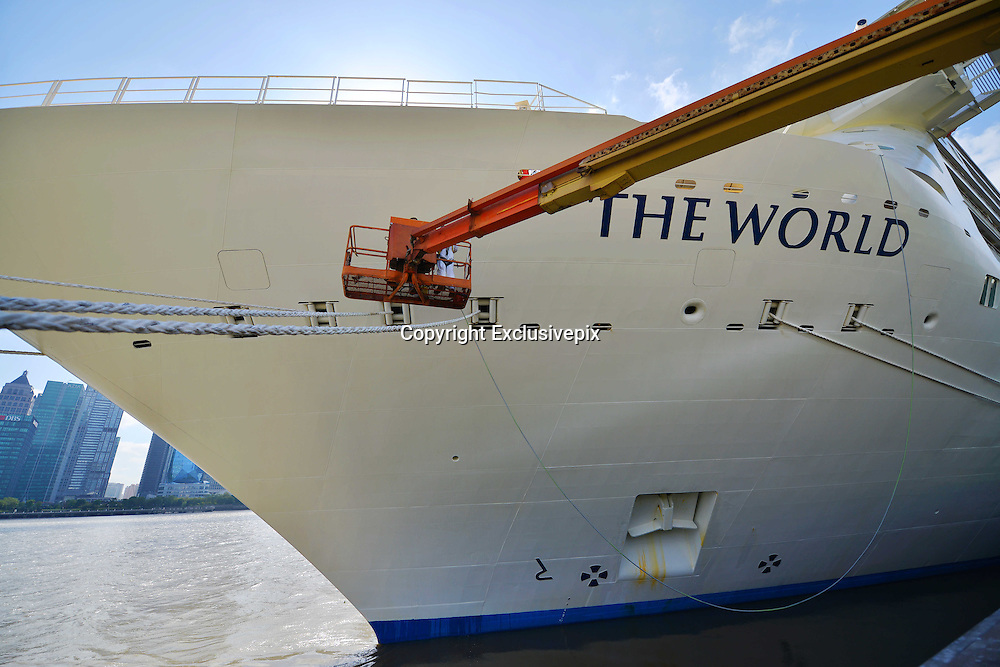 """SHANGHAI, CHINA - OCTOBER 28: (CHINA OUT) <br /> <br /> World's Largest Luxury Cruise Arrives In Shanghai<br /> <br /> One of the world's largest luxury cruise called The World arrives at Shanghai port on October 28, 2014 in Shanghai, China. One of the world's largest personal luxury cruise called """"The World"""" contains 198 cabins and 165 luxurious apartment. <br /> ©Exclusivepix"""