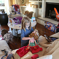 Lauren Wood | Buy at photos.djournal.com<br /> Siblings Olivia, 6, from left, Maisy, 4, and Gabe Shoumaker, 7, play with some of their Christmas presents at their family's Tupelo home on Christmas day. The three siblings were adopted by Mitchell and Dustin Shoumaker from Poland, and they arrived home on Dec. 23, 2015.