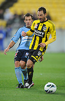 Sydney's Alessandro del Pier, left, is tackled by Wellington Phoenix's Andrew Durante in the A-League foootball match at Westpac Stadium, Wellington, New Zealand, Saturday, October 06, 2012. Credit:SNPA / Ross Setford