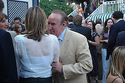 Caroline Woolton and Andrew  Neil. The Business Summer party hosted by Andrew Neil. Italian Hotel, Ritz Hotel. 12 July 2005. ONE TIME USE ONLY - DO NOT ARCHIVE  © Copyright Photograph by Dafydd Jones 66 Stockwell Park Rd. London SW9 0DA Tel 020 7733 0108 www.dafjones.com