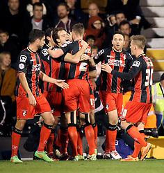 Bournemouth's Brett Pitman celebrates with teammates - Photo mandatory by-line: Robbie Stephenson/JMP - Mobile: 07966 386802 - 06/03/2015 - SPORT - Football - Fulham - Craven Cottage - Fulham v AFC Bournemouth - Sky Bet Championship